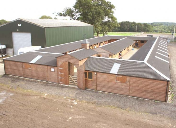 The quad shape is very popular for large stable blocks, it creates a more compact working area and provides greater protection from the elements. The central space can be used for additional buildings such as hay barns, wash down bays or even a central office. This stable block includes 26 stables, tack rooms, office, covered walkway …
