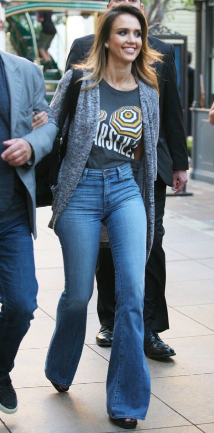 Jessica Alba traded in her denim skinnies for a wide-leg silhouette that she styled with a tucked-in graphic tee that she styled with a slouchy marled-knit gray cardi and black open-toed heels. #InStyle
