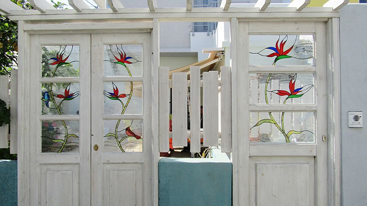 Handmade wooden doors with stained glass