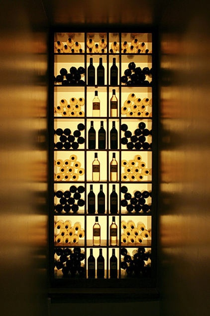 Backlit shelving allows the shape of the bottles to be used almost like art. The play of light off the walls adds another interesting set of textures and colors.