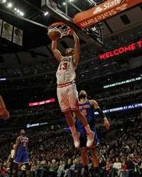 Joakim Noah #13 of the Chicago Bulls dunks over Tyson Chandler of the New York Knicks at the United Center http://www.fansedge.com/Joakim-Noah-Chicago-Bulls-1282012-_-1479484510_PD.html?social=pinterest_pfid77-27501