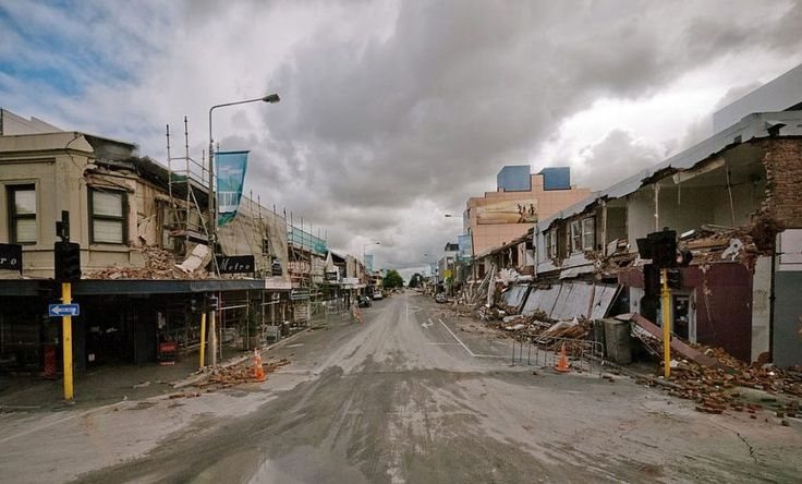 A picture shows rubble and damaged buildings lining a deserted Colombo street in Christchurch on February 23, 2011, following an earthquake. New Zealand declared a national state of emergency on February 23 after one of its worst earthquake disasters left nearly 400 people dead or missing. AFP PHOTO / LOGAN MCMILLAN (Photo credit should read Logan McMillan/AFP/Getty Images)