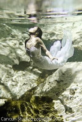 Bride underwater like a mermaid