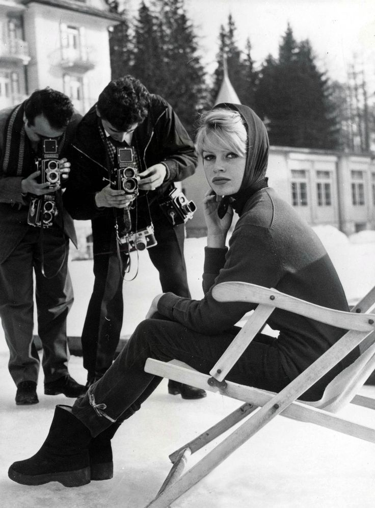 Bridget Bardot goes barehanded with a light headscarf in the Southern Alps of Italy. Our thoughts: Oeuvre d'art.   - TownandCountryMag.com