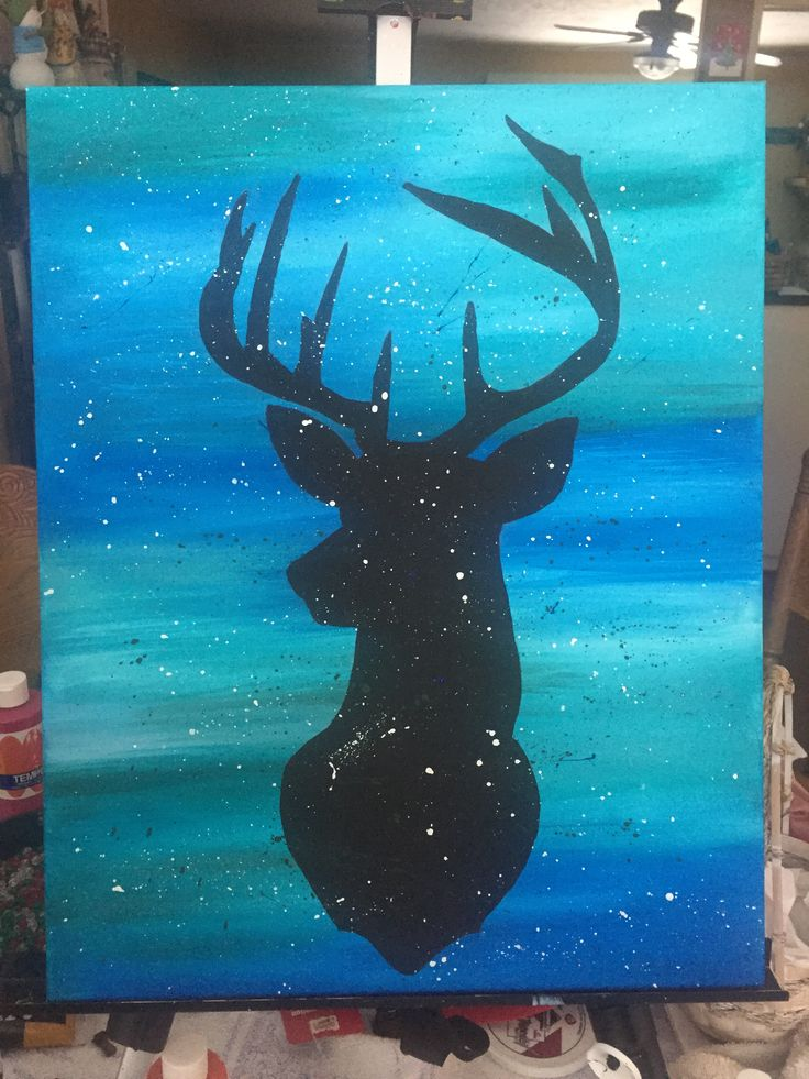 Deer silhouette on blue background with splatter. I did it!!
