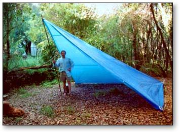 As a Boy Scout, I spent many nights in a trail tent like this. It was usually tied at the peak to a tree rather than to a pole like the one shown. We made and waterproofed our own tents from three strips of muslin. Well, our mothers usually did the sewing.