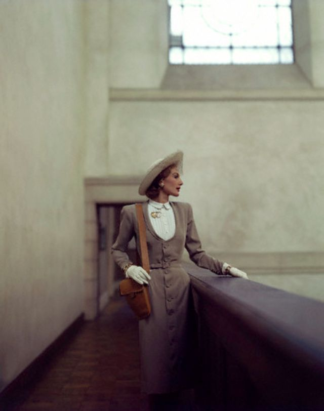 ca. 1944 --- Model wearing button-front 'dress coat' of tan wool gabardine, a Vogue pattern.. vintage everyday: Extraordinary Color Fashion Photography Taken During the 1940s by John Rawlings