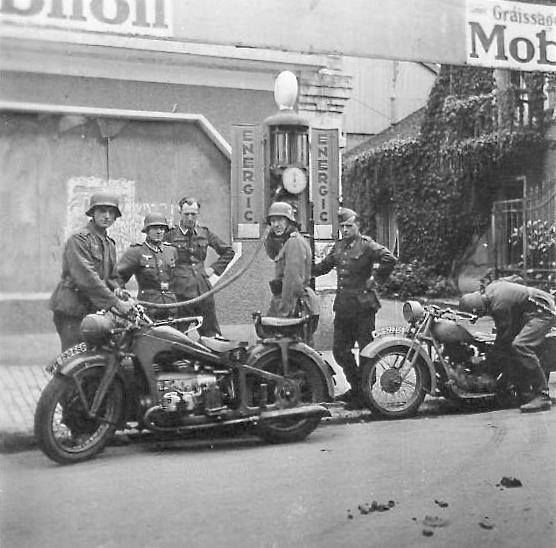 Soldiers fueling a Zundapp KS750 with DKW 125 waiting it's turn