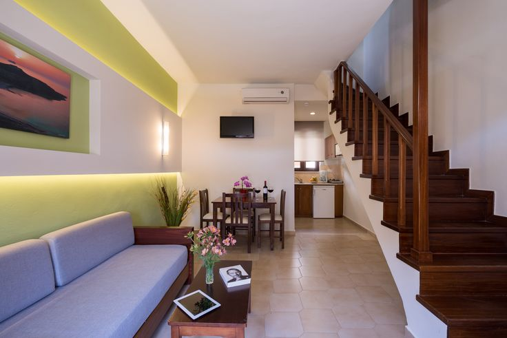 The spacious and bright two floor apartments with complete dining area, fully equipped kitchen and sofa, TV table and TV