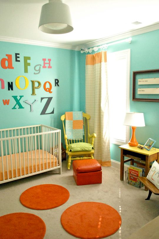 Nursery decor. Like the bright colors and wall letters. Would probably trip over those rugs, though.