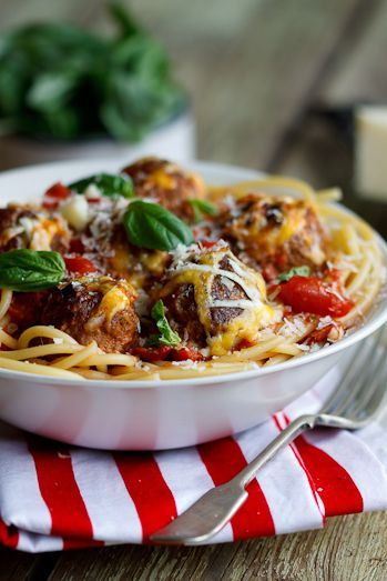 Cheesy meatballs baked in tomato sauce from Simple  Delicious. #Cookbook #Recipe #Food #Pasta #foodphotography