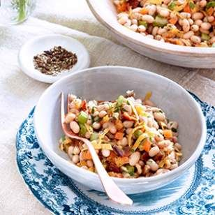 Roasted garlic adds rich flavor to the dressing, and red bell pepper adds color in this healthy bean salad recipe.
