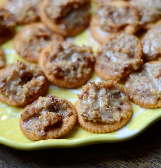 Chewy, Sweet & Salty Ritz Cracker Cookies makes 36 to 48 cookies, depending on amount of topping used per cracker 1/2 cup walnuts 1 cup dried dates 1 14-ounce can sweetened condensed milk 1/4 to 1/2 pound Ritz crackers (1 to 2 sleeves of crackers)  1/2 cup powdered sugar 1/4 teaspoon ground cinnamon 1/4 cup milk 1/2 teaspoon vanilla