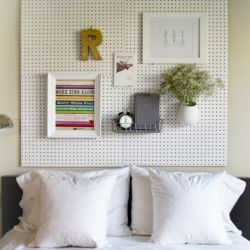 DIY pegboard headboard. It's simple, inexpensive, and you can change your decor as much as you'd like! I could see this beinga great thing in a teens room.