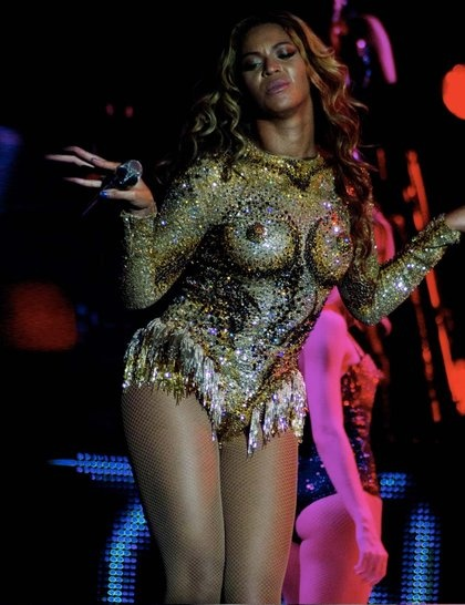 A gold sequined bodysuit with trompe l'oeil breasts - a collaboration between The Blonds, Tina Knowles and stylist Ty Hunter - is a showstopper. Beyonce's Mrs Carter tour