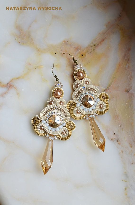 Long and awesome, hand made soutache earrings in cream and gold. Ive used Swarovski crystals - round rivolis, small bicones and very large drops in