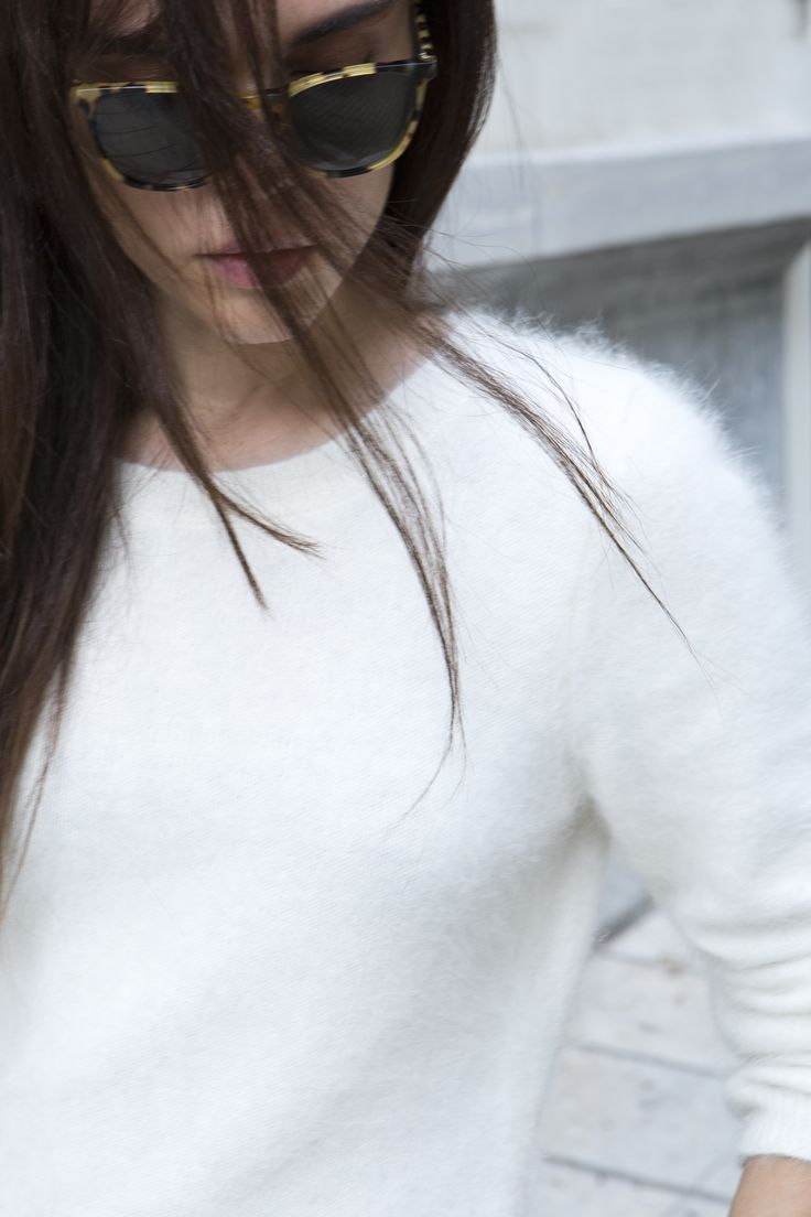 Fluffy white jumper and statement sunglasses