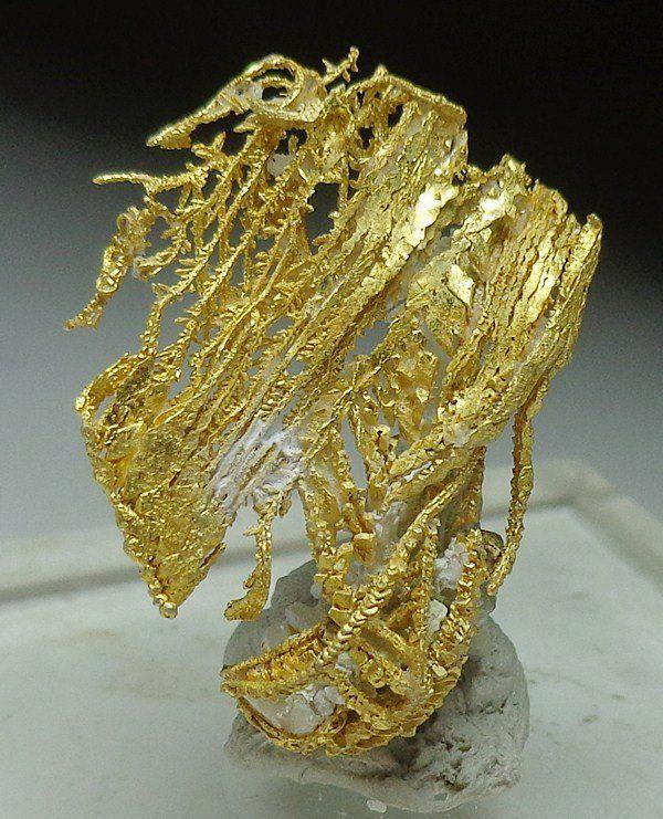 Gold on quartz from Round Mountain mine, Nye County, Nevada, Southwest USA.