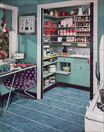 This is an amazing pantry in this 1952 vintage turquoise kitchen. Plus that bench has dots!