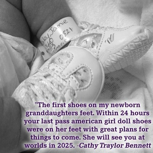 Doll cheer shoes on baby's feet