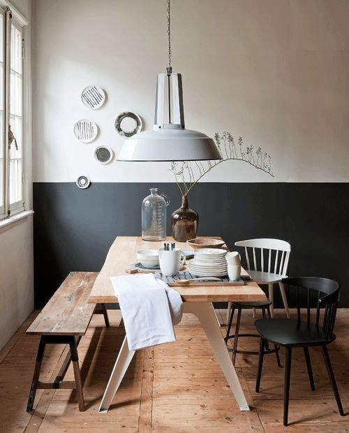 Scandinavian Dining Room With Black & White Wall And Wooden Dining Table
