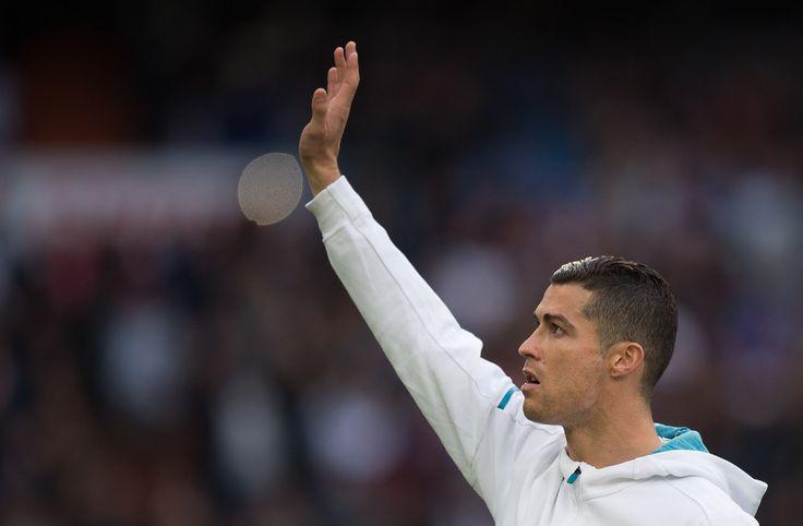 Cristiano Ronaldo Photos - Cristiano Ronaldo of Real Madrid waves before the start of the La Liga match between Real Madrid and Sevilla at Estadio Santiago Bernabeu on December 9, 2017 in Madrid, Spain. - Real Madrid v Sevilla - La Liga