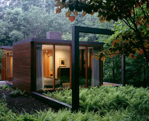 Modern cabins a black steel framed guesthouse cozy for Steel frame cabin