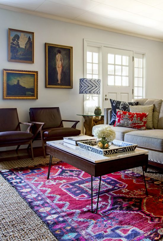 Naomi Stein of DesignManifest has no fear with it comes to blending patterns, employing ikat, pagoda print, a bright Hamadan rug, and a chevron lampshape all in one cozy space. Pair with vintage chairs and a hairpin-leg coffee table, the effect is layered, original, and thoroughly modern.