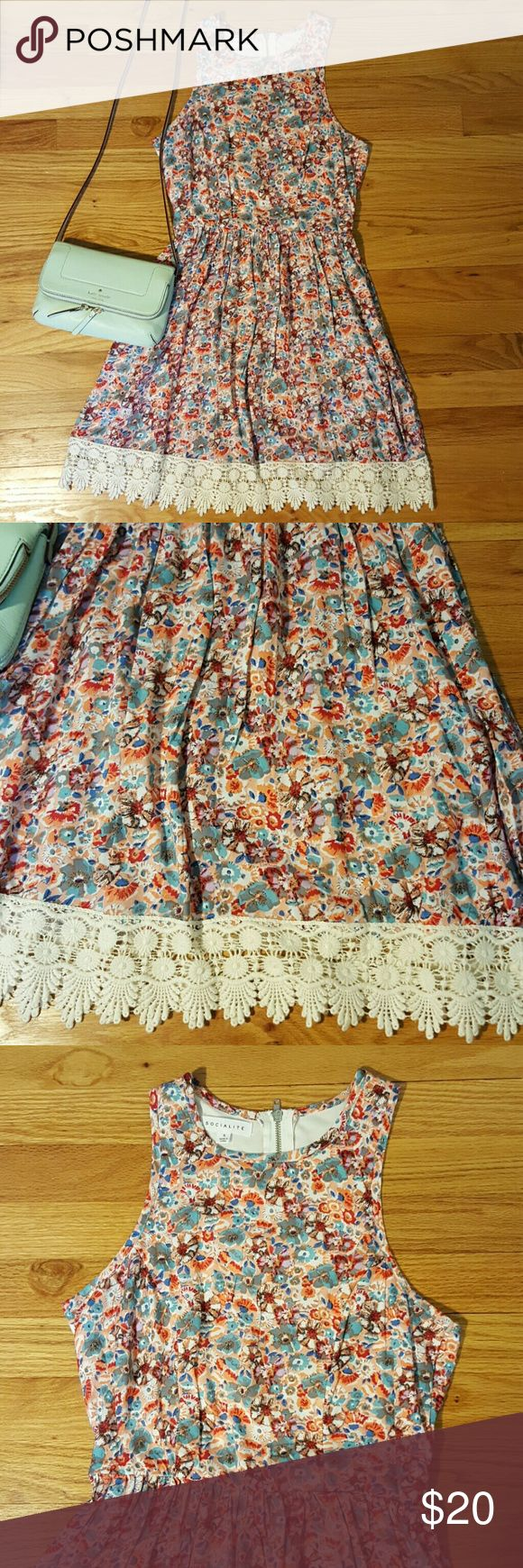 "Socialite floral fit and flare dress S New without tags, never worn!  Cute dress by Socialtite from Nordstrom.  Floral print in peach, red, light blue, and lavender.  Cream lace trim along the hemline.  Fit and flare style with defined waist- would look great with a belt.  Top has higher rounded neckline and narrow shoulders, strapless or racerback bra recommended underneath ??  Has exposed zipper along center back.  Perfect summer mini dress!  Measures 30"" around bust, waist is stretches…"