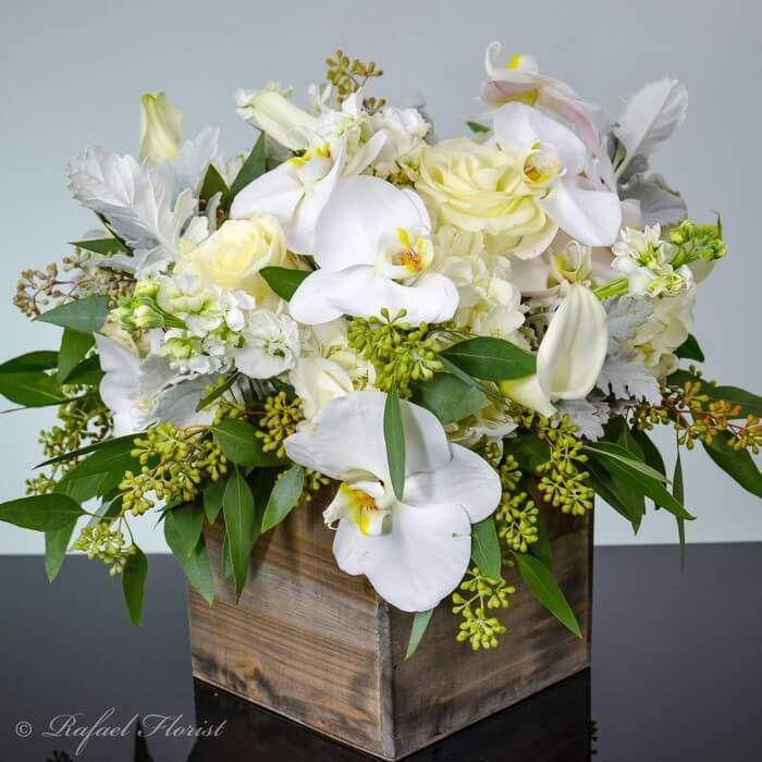 Rustic Floral Design Of White Phalaenopsis Orchids Roses Calla Lilies Rustic Flower Arrangements Orchid Arrangements Flower Arrangements