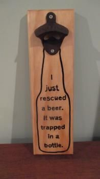 "Rescued Beer.jpg Love this saying in the bottle. I love this!!! Great wall mounted magnetic beer bottle opener. Great addition to any bar, dorm room, man cave. Great groomsman gift for the wedding party. Caps stick to front after opening bottle. Magnets imbedded in the back then covered with a faux leather. Wall mounting hardware on back. Hand Painted. Can be purchased at www.freedspirits.biz Approx 12""H x 4""W"