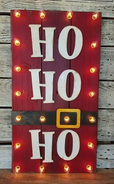 Ho Ho Ho Wood Plank sign - simple, fun, and creative - love the lights too! You've finished your Christmas crafts and cookies and now it's time to put up your Christmas decorations. You're going to love these Christmas ideas! | Christmas Crafts