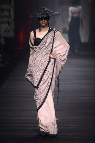 Sarees by Tarun Tahiliani on AW 11. To view, visit:  http://www.vogue.in/content/25-saris-stylish-wedding-season#19