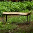 A rustic industrial bench made out of a 100+ year old sycamore tree with a live edge.