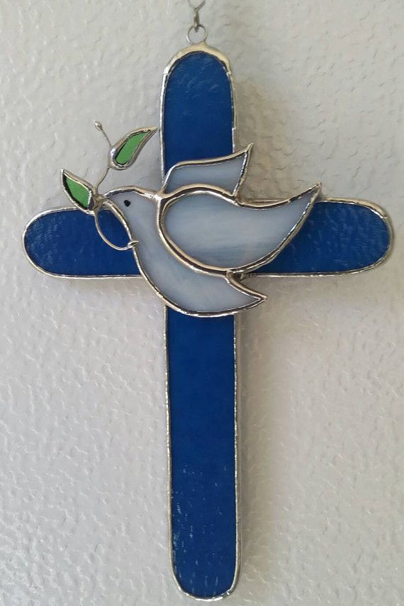 *** MADE ON ORDERING - ALLOW 2 WEEKS FOR DELIVERY *** A beautiful reminder of your baptism. We used blue opalescent glass for the cross. A white dove with olive branch is the central point. Dimensions