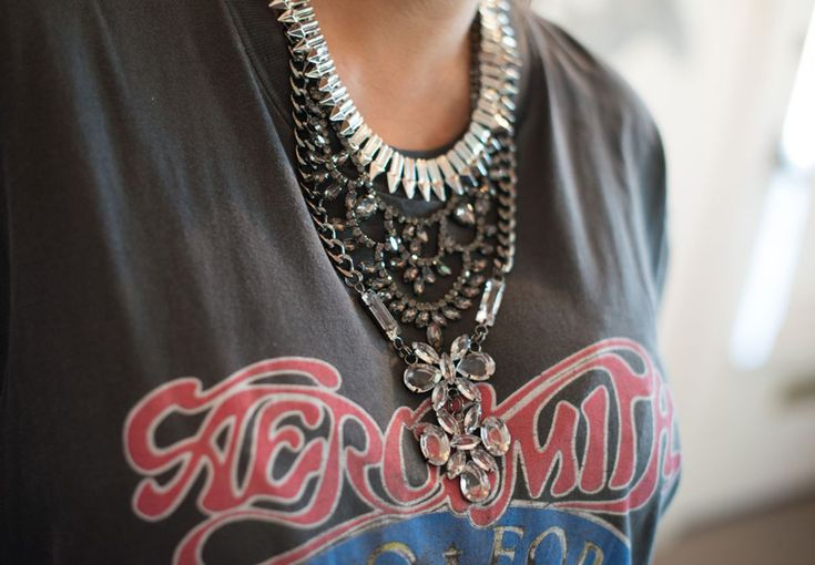 love any outfit that includes large layered necklaces (fancy & edgy) being worn over vintage T-shirt.