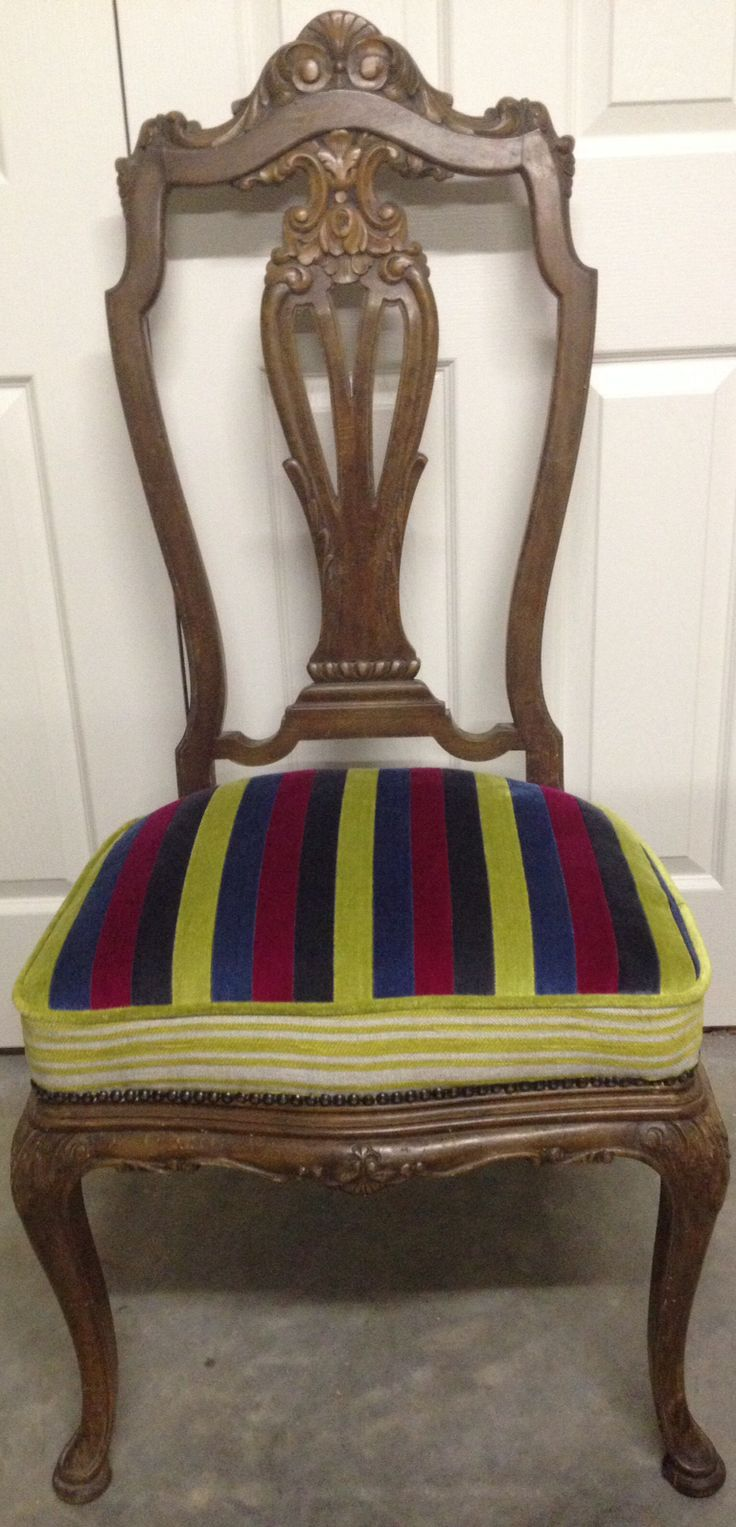 An old antique chair....  It needed a whole new base and some vibrant fabric to make it special again