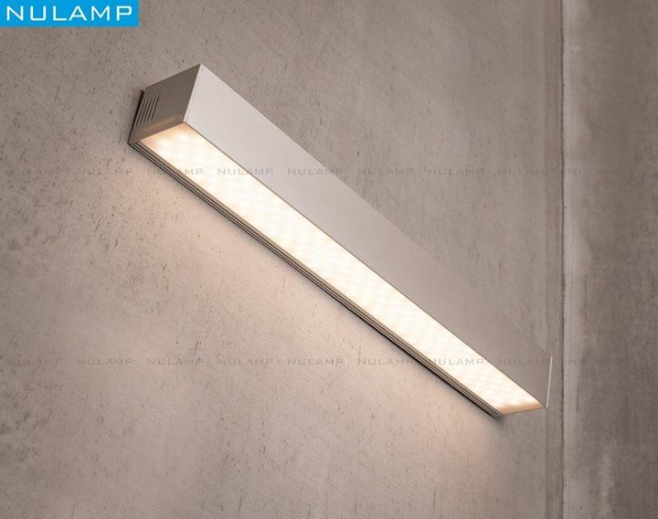 We present you a NULAMP: IKON K a LED wall lamp with a light source pointing down. Energy-efficient linear LED lighting with two or more parallel light lines designed for easy attachment to a ground. Lamp construction enables easy surface mounting the lamp  consisting of two parts: U (main part with LED rails and electronic gear) and Z (part attached to the ground) connect by click. A specially designed HSP47 cover (opal glass or transparent) made of polycarbonate has a certificate that…
