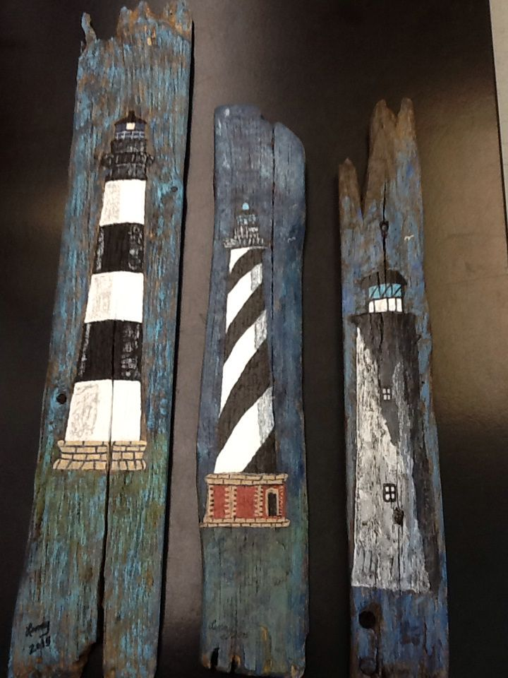 Acrylic paintings of Bodie Island, Cape Hatteras and Ocracoke Lighthouses on driftwood