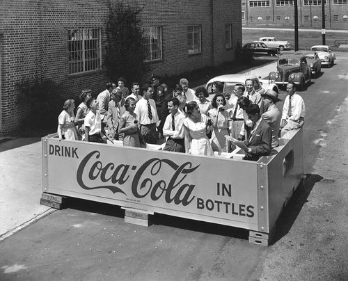 People in large Coca-Cola crate - 1953