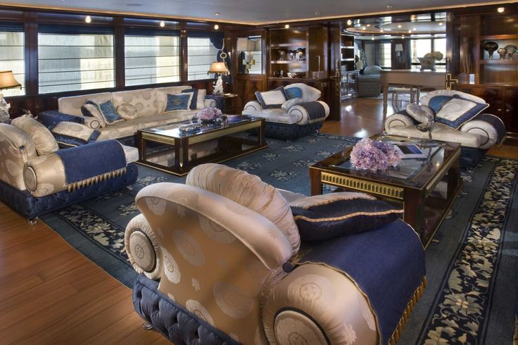 On M/Y CRN Blue Eyes of London 60m a central sliding door leads to the main hall with comfortable custom-made oriental sofas made from blue-dyed white Venetian silk matching the carpet and the silk curtains. The lamps depict symbolic figures of the Dragons of China.