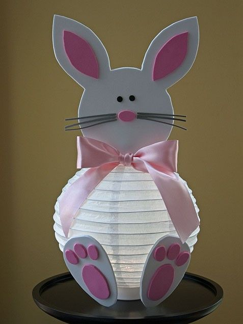 Easter Bunny Latern    What you'll need:Paper lantern, craft foam paper, hot glue, ribbon (optional)    How to make it: The lantern will be the body of your bunny. Simply have your kids embellish the paper lantern by adding the face and the feet of the bunny using pink and white foam paper. Then hot glue all of the parts to the lantern for a finished product.