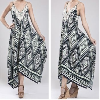 Draped asymmetrical dress with vibrant colors and patterns. Love to look effortlessly elegant while still being able to enjoy the summer weather? This dress is for you. $42.  #J.Elizabeth #SummerWear #SummerDresses