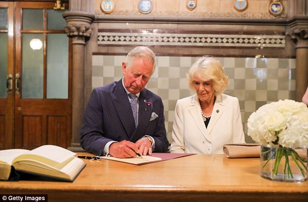 The royal pair signed a book of condolence after the reception at Manchester Town Hall, writing to thank all emergency service personnel and giving their best wishes to the families who lost loved ones
