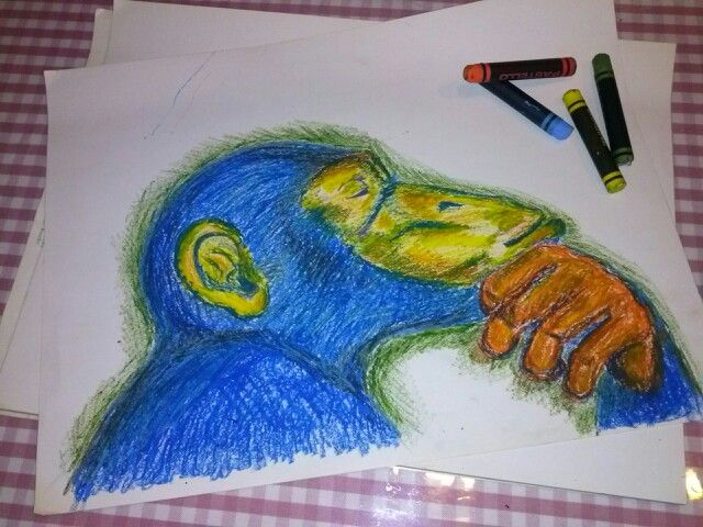 Monkey in blue, yellow, green & orange