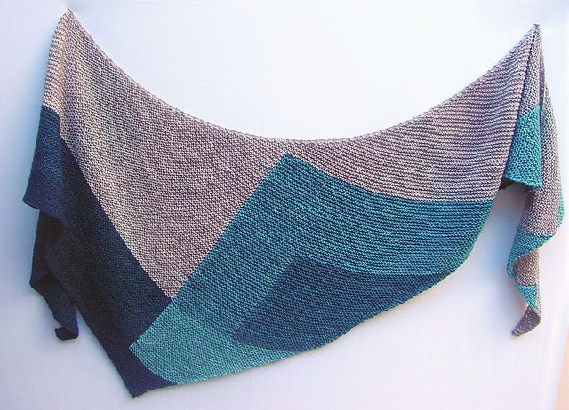 What's Your Favorite Color is an asymmetric, triangular wrap knit on the bias. It features garter stitch and intarsia. Trust me this is not scary, hard, tons of bobbins and charts intarsia. There's no chart, minimal counting and since the pattern uses mini skeins your yarn will already be in neat little bundles.