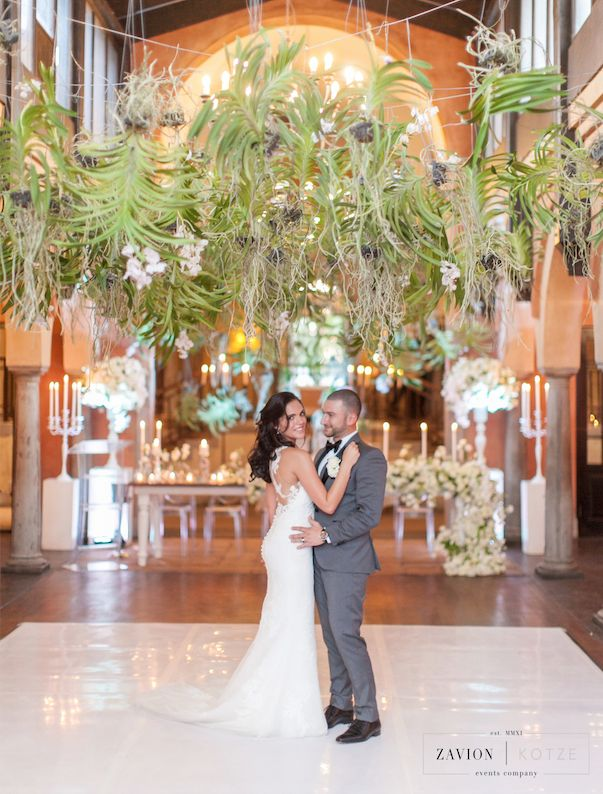 Hanging Orchid Ceiling, Orchid Roof, suspended Orchid Ceiling with white orchid mass arrangements. White floral runners, white roses, white orchids. Green and white wedding. Hanging flowers wedding.