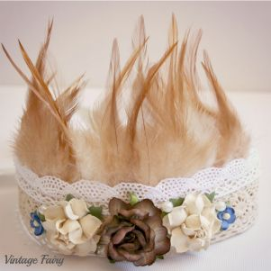 Welcome to Vintage Fairy Exquiste soft feathers are the main feature of this crown. The flowers are neutral and would match in with many outfits for many occasions. This crown was designed to match the gorgeous dress by Spool Couture, The lovely neutral lace and flowers coordinate so perfectly with the lovely colours you see in the dress. A perfectly designed outfit for your sweet one. This crown will fit ages one year and up.It ties in the back to extend the length as you...