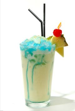 the swimming pool | 1½ ozs white rum ¾ oz vodka 2 oz pineapple juice ¾ oz cream of coconut ¼ oz cream 1½ cups crushed ice ¼ oz blue curacao | mix all ingredients except blue curacao. add blue curacao over the top to form the pool.