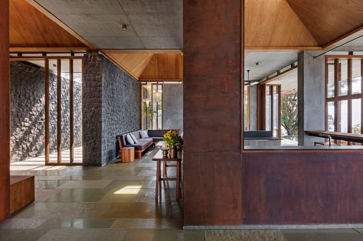 Volcanic basalt stone that clads both exterior and some interior walls. The stone is common in the region, so the design team were able to source it from the clients' land.